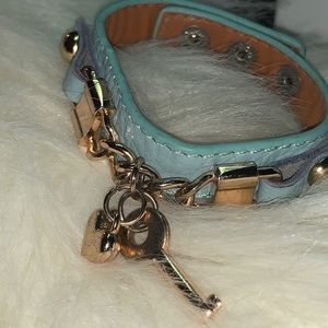 Blue faux leather bracelet; key and heart charm
